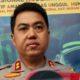 Kapolres Malang Kota AKBP Dony Alexander SIK MH saat menunjukan gambar hasil rekaman CCTV kejahatan MS dan E. (gie)