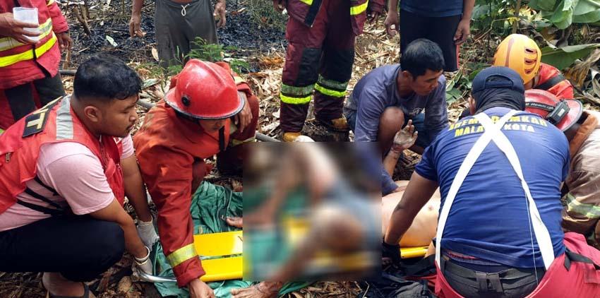 Ahmad Zamroni saat dievakuasi oleh rekan rekannya. (ist/ PMK Kota Malang)