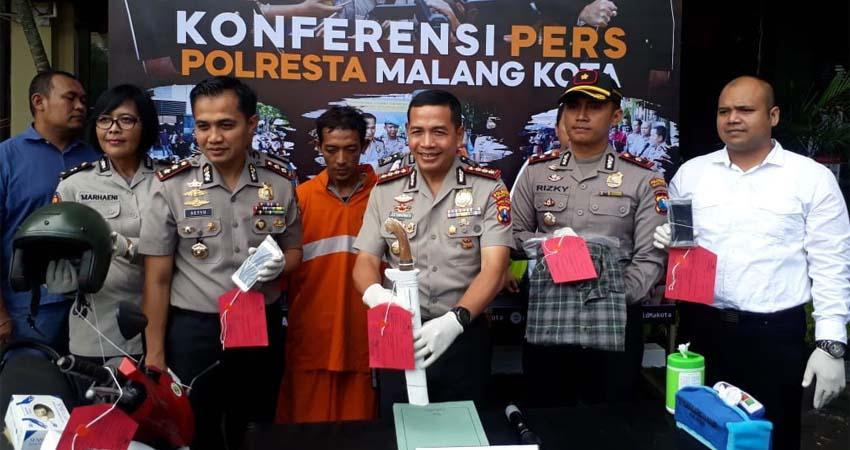 Tersangka Zan saat dirilis di Mapolresta Malang Kota. (gie)
