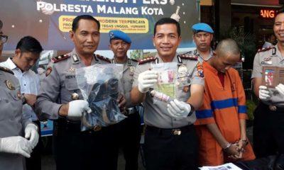 TUYUL : Tersangka Dika Pratama Putra saat dirilis di Polresta Malang Kota. (gie)