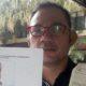 Ramot Batubara SH menunjukan foto Lickmanto. (gie)