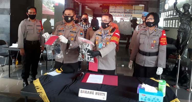Tersangka Andrie saat dirilis di Mapolresta Malang Kota. (gie)