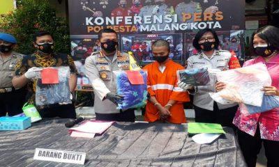 Tersangka SA alias Asul saat dirilis di Polresta Malang Kota. (gie)